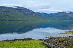 Coastline and landscape along the Isafjordur fjord. View of coastline and landscape along the Isafjordur fjord, in the west fjords region, Iceland Stock Photos