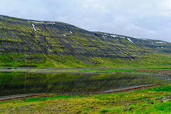 Coastline and landscape along the Isafjordur fjord. View of coastline and landscape along the Isafjordur fjord, in the west fjords region, Iceland Royalty Free Stock Photo