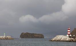 Coastline landscape with lighthouse. Madalena port. Pico island. Stock Photography