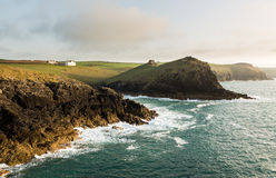 Coastline in late evening sun at Port Quin Royalty Free Stock Image