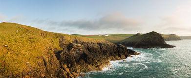 Coastline in late evening sun at Port Quin Stock Photography