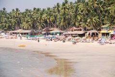 The coastline with loungers and thatched sunshade stock image