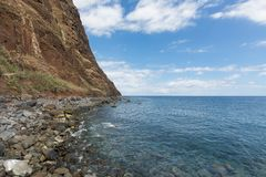 Coastline of Madeira with high cliffs along the Atlantic Ocean Stock Photography
