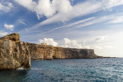 Coastline in Malta, Comino island with St. Mary's Tower Royalty Free Stock Photography