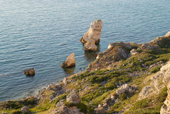 A coastline with many big rocks. Stock Image