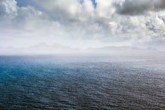 Coastline in the mist along a Saint Kitts and Nevis island Stock Photos