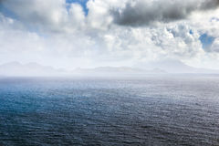 Coastline in the mist along a Saint Kitts and Nevis island Stock Photography