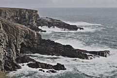 Coastline of Mizen Head in stormy weather Royalty Free Stock Image