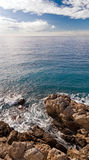 Coastline in Nice with rocks and waves. Cote d'Azur, France Royalty Free Stock Photography