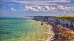 Coastline in Normandy. In Northern France, during the low tide time Royalty Free Stock Photo