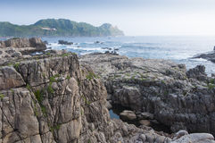 Coastline of Northeastern Taiwan. This photo was taken in a tranquil morning at Long Dong, Taipei, Taiwan. The sky is clear. The wave is low. It's such a great stock photography