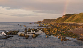 Coastline Rainbow. Rainbow over Moray Coastline, Scotland stock images