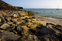 Coastline rock beach  waand summer in lanzarote spain Stock Photos