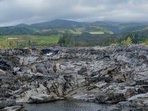 Coastline and rugged lava rocks called Dragon's Teeth at Makaluapuna Point near Kapalua, Maui, H. Coastline and rugged lava rocks called Dragon's royalty free stock images