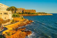 Coastline at Salou with buildings during summertime sunset.