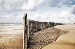 Coastline_Sanddunes_Fence. Fence on the beach near the sea to keep the sand from moving stock photos