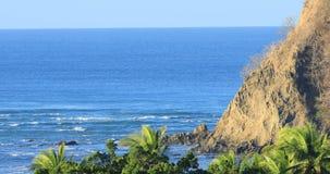Coastline scene in Costa Rica with rocky shore 4K. A Coastline scene in Costa Rica with rocky shore 4K stock footage