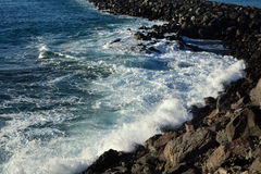 Coastline scene with rocks and sea waves from southern Tenerife .Canary Islands.Spain. Stock Photography
