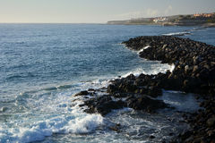 Coastline scene with rocks and sea waves from southern Tenerife .Canary Islands.Spain. Stock Photos