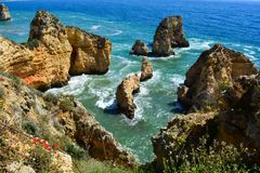 Golden cliffs of Lagos in Portugal. The coastline scenic view in Lagos, Portugal Royalty Free Stock Image