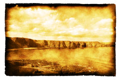 Coastline of Scotland  -  photo on burnt paper Royalty Free Stock Photo