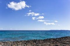 Coastline, sea, island, sky and clouds Royalty Free Stock Photo