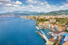 Coastline Sorrento city, Italy. Aerial view of coastline Sorrento city and Gulf of Naples - popular tourist destination in Italy. Sunny summer day with blue sky Royalty Free Stock Image