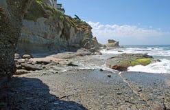 Coastline south of Aliso Beach in Laguna Beach, CA. Image shows the rocky coastline just south of Aliso Beach in Laguna Beach, California. Conglomerate rock stock image