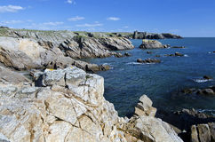 Coastline of South of Yeu Island at old castle. Rocky wild Coastline of South of Yeu Island, ruins of old castle at fare background. France, Vendee, Pay de la Royalty Free Stock Photography