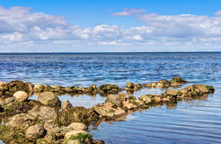 Coastline with stones Royalty Free Stock Images