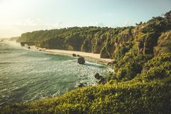 The coastline surrounded by the cliffs. Sumba. stock image