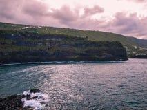 Coastline (Tenerife - Canary Island, Spain). Green coast - purple sky - clouds Royalty Free Stock Images