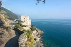 Coastline with tower. Limpid water of the Mediterranean - Cinque Terre - Italy Stock Photo