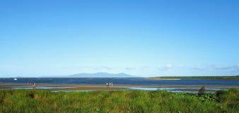 Coastline, in Townsville Australia. Landscape, seascape people walking on beach Royalty Free Stock Photos