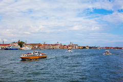Coastline of venice. Coastline in venice with many historical buildings and boats Royalty Free Stock Photos