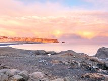 Coastline view at Dyrholaey in Iceland. Coastline view with mountains near Dyrholaey, Vik town in Iceland, during twilight evening sky in winter season royalty free stock image