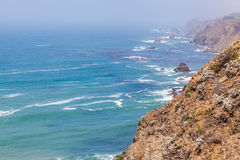 The Coastline. View of the Pacific Ocean on the Mendocino Coastline from highway 1 an emerald turquoise water near reef and rock formation Royalty Free Stock Photography