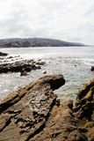 Coastline view from a rocky ledge of California beaches. Vacation destinations. Stock Photo