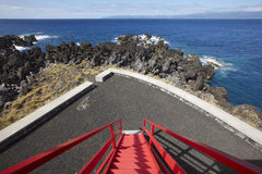 Coastline viewpoint with red stairs in Pico island. Azores. Port Stock Image