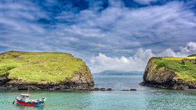 Coastline of Wales. Fishing boat on the coast of Wales stock image
