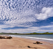 Coastline with walkers in Dingle, Ireland. The Dingle coast is characterized by beautiful rock formations Royalty Free Stock Images