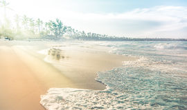 Coastline with waves, sand and haze Royalty Free Stock Image