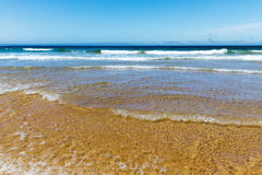 Coastline with waves. Of the sea on the sandy summer beach, Portugal Stock Photography