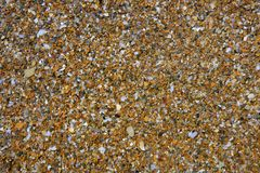Coastline wet stones pattern background. On Mediterranean sea Royalty Free Stock Images