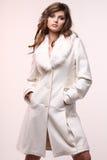Coat. Young beautiful woman wearing white coat Stock Photos