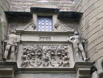 Coat of Arms. This part of an entrance gate of a German castle shows two knights and the coat-of-arms of the noble family that lived there in the Middle Ages Stock Photography
