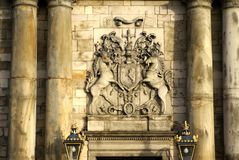 Coat of arms on the Holyrood Palace in Edinburgh, Scotland. Coat of arms above an entrance to the Palace at Holyroodhouse at the end of the Royal Mile in Royalty Free Stock Photo