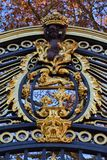 Coat of arms as decoration of the gate of a palace in London stock images