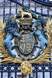 Coat of arms as decoration of the gate of a palace in London royalty free stock image
