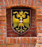 Coat of arms of Austria. Over brick wall Stock Photography